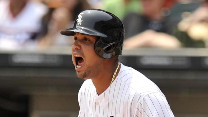 Chicago White Sox's Jose Abreu (79), yells at teammate Melky Cabrera to run to third base after Abreu scored on an Avisail Garcia single during the first inning of a baseball game against the Baltimore Orioles Saturday, July 4, 2015, in Chicago. (AP Photo/Paul Beaty)