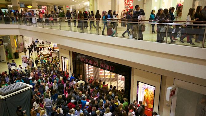 Shoppers position themselves for the midnight opening of many stores at the Clackamas Town Center for Black Friday sales Thursday Nov. 22, 2012. (AP Photo/The Oregonian, Randy L. Rasmussen)