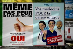 Campaign posters promoting a single public health insurance…
