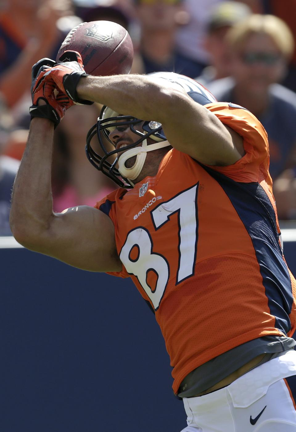 Denver Broncos wide receiver Eric Decker (87) catches a touchdown pass from quarterback Peyton Manning during the first quarter of an NFL preseason football game against the San Francisco 49ers in Denver, Sunday, Aug. 26, 2012. (AP Photo/Joe Mahoney)
