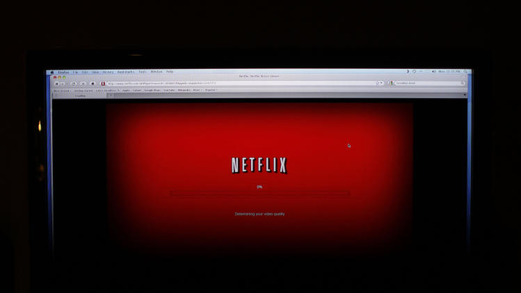 "FILE - In this Monday, Nov. 22, 2010, file photo, a movie selected from among Netflix's ""Watch Instantly"" titles begins to download on a home computer screen in New York. Netflix is testing new price plans for streaming video as it tries to lure more viewers. (AP Photo/James H. Collins, File)"