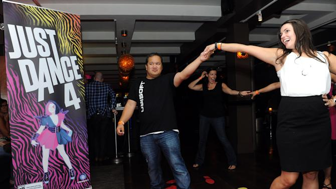 COMMERCIAL IMAGE - Guests enjoy Just Dance 4 on Kinect for Xbox 360 at Ubisoft's NYC Dance Party showcasing their upcoming line-up of dance video games, Wednesday, Aug. 22, 2012, at New York's Empire Hotel.  (Photo by Diane Bondareff/Invision for Ubisoft/AP Images)