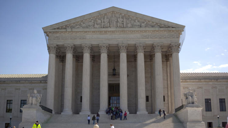 """FILE - In this April 9, 2010 file photo, the Supreme Court is seen in Washington.  The Supreme Court on Friday allowed the """"don't ask, don't tell"""" policy on gays in the military to remain in place while a federal appeals court considers the issue.  (AP Photo/Evan Vucci, File)"""