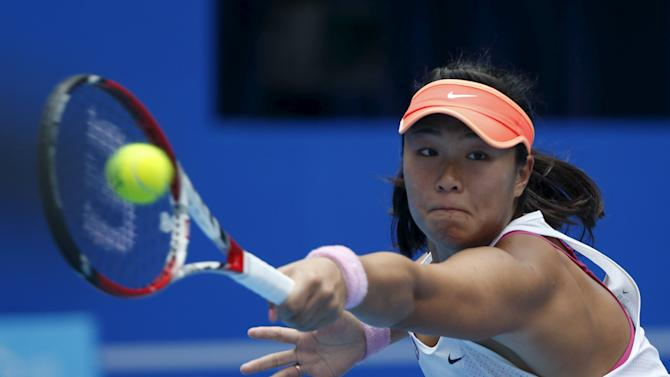 Han Xinyun of China hits a return against Flavia Pennetta of Italy during their women's singles match at the China Open tennis tournament in Beijing