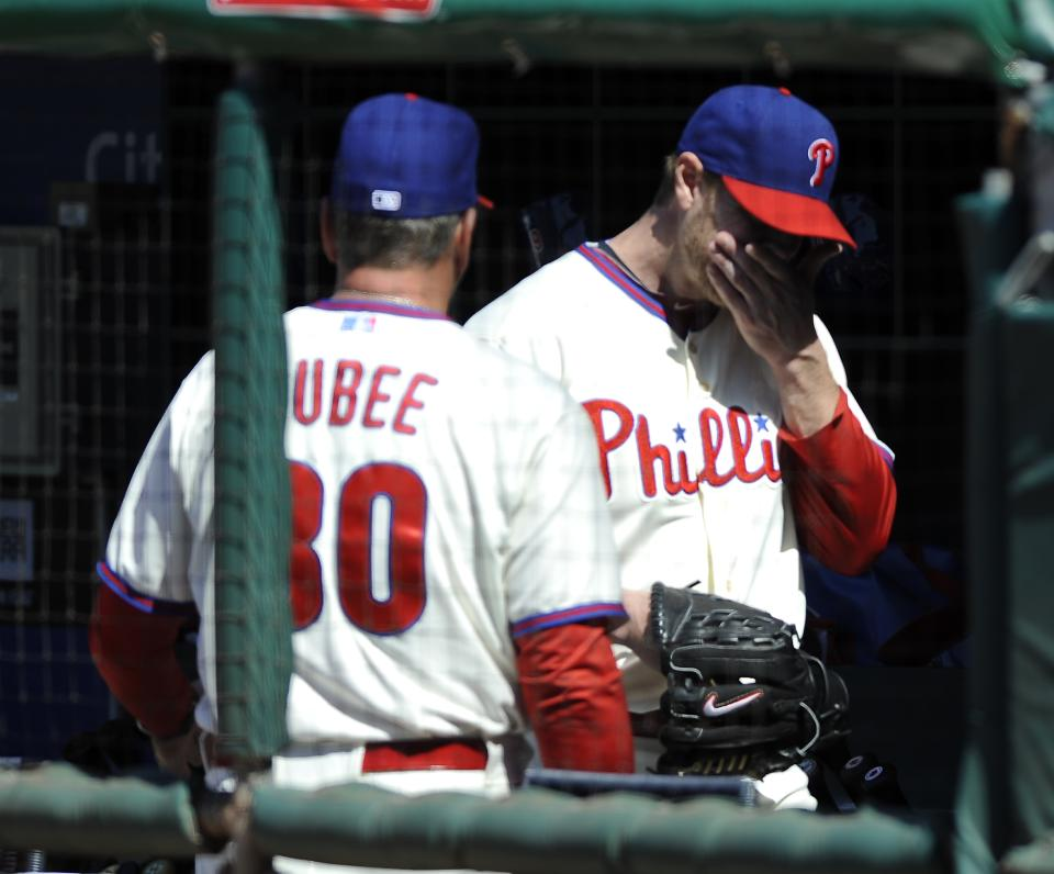 Philadelphia Phillies' Roy Halladay, right, walks past Rick Dubee after being taken out in the third inning of a baseball game on Sunday, May 5, 2013, in Philadelphia. (AP Photo/Michael Perez)