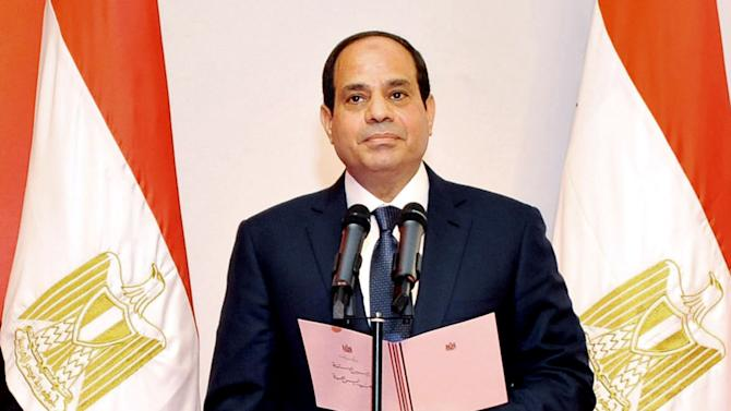 FILE - In this Sunday, June 8, 2014 file photo released by the Middle East State News Agency, President Abdel-Fattah el-Sissi, takes his oath of office at the Supreme Constitutional Court in Cairo, Egypt. El-Sissi said Tuesday, June 24, 2014 he will not interfere in court rulings, a day after three Al-Jazeera English journalists, including a Canadian, were sentenced to seven years in prison, sparking an international outcry. Egyptian-Canadian Mohamed Fahmy, Australian Peter Greste and Egyptian Baher Mohamed were found guilty on Monday on terrorism-related charges. (AP Photo/MENA, File)