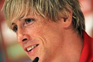 Spain&#39;s national football team player Fernando Torres smiles during a press conference after a public training session in Schruns on May 28, 2012. AFP PHOTO / ALEXANDER KLEIN