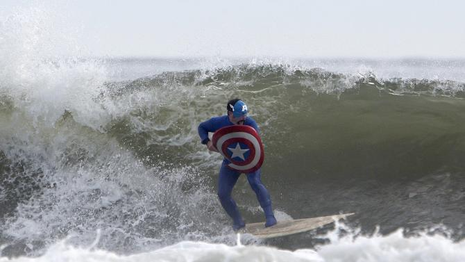 A participant surfs during the third annual Rockaway Halloween surf competition at Rockaway Beach in the Queens borough of New York