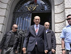 Former Slovenian Prime Minister Jansa reacts as he steps out of the court after his corruption trial involving Finnish company Patria in Ljubljana