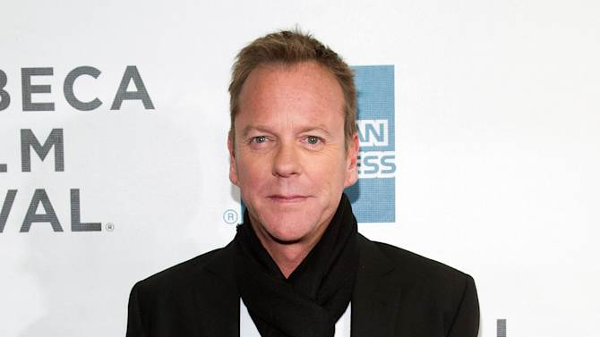 """FILE - This April 21, 2013 photo shows actor Kiefer Sutherland at the premiere of """"The Reluctant Fundamentalist"""" during the 2013 Tribeca Film Festival in New York. Sutherland, known for his terrorist-hunting role on """"24,"""" says the attacks of Sept. 11 had a profound effect on him, but he focused on the great loss in this country. He says the new film shows how the attacks had a """"ripple effect"""" that resulted in """"the things I had the most: racism, prejudice, ignorance, fear.""""  (Photo by Dario Cantatore/Invision/AP, file )"""