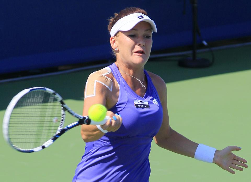 Agnieszka Radwanska, from Poland, hits a forehand shot against Sloane Stephens during a match at the Western & Southern Open tennis tournament, Thursday, Aug. 16, 2012, in Mason, Ohio. (AP Photo/Al Behrman)