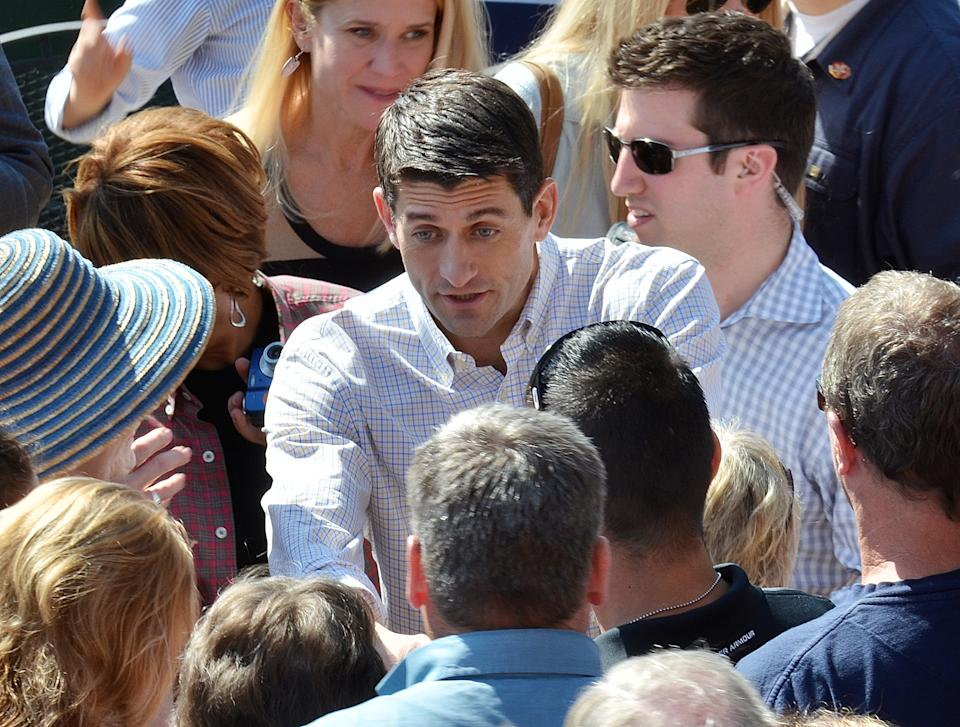 "Republican vice-presidential candidate Paul Ryan greets supporters after his speech at Elly's Tea and Coffee House, Tuesday, Oct. 2, 2012, in Muscatine, Iowa. Ryan is on his ""Victory in Iowa"" bus tour. (AP Photo/Muscatine Journal, Beth Van Zandt)"
