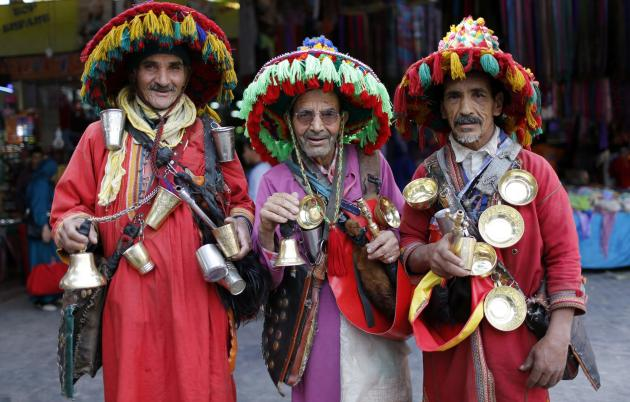 Men in traditional costume pose at the old market of Agadir city in southwest Morocco