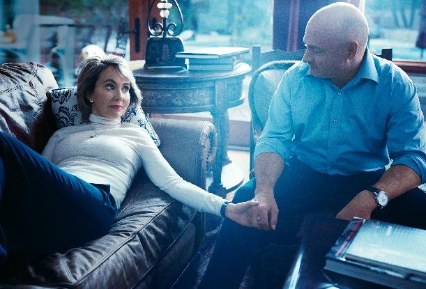 This undated image provided by Vogue shows former Rep. Gabrielle Giffords, D-Ariz., left, with her husband, former astronaut Mark Kelly, during a photo shoot at their home in Tucson, Ariz. The image a