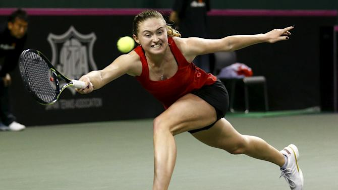 Sasnovich of Belarus returns a shot to Morita of Japan during their Fed Cup tennis match in Tokyo