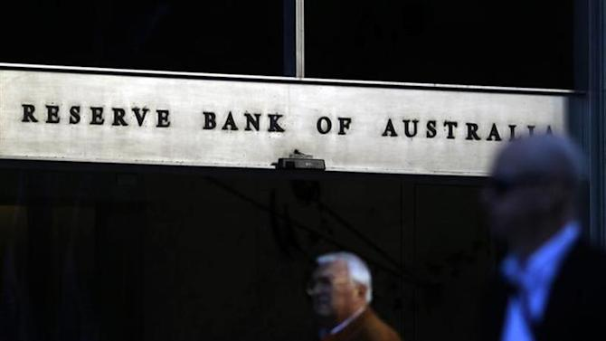 Sun reflects off the front door sign of the Reserve Bank of Australia building in Sydney July 5, 2011. REUTERS/Tim Wimborne/Files