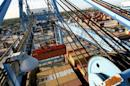 Crews load and unload consumer products at the Port of New Orleans along the Mississippi River in New Orleans, Louisiana