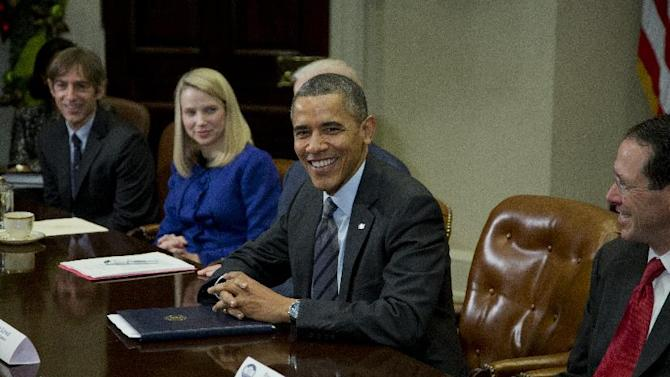 President Barack Obama meets with technology executives in the Roosevelt Room the White House in Washington, Tuesday, Dec. 17, 2013. From left are, Mark Pincus, founder, Chief Product Officer & Chairman, Zynga; Marissa Mayer, President and CEO, Yahoo!, Obama, and Randall Stephenson, Chairman & CEO, AT&T. (AP Photo/ Evan Vucci)