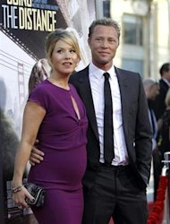 Cast member Christina Applegate and her fiance Dutch bass player Martyn Lenoble pose at the premiere of &quot;Going the Distance&quot; in Hollywood, California August 23, 2010. REUTERS/Mario Anzuoni