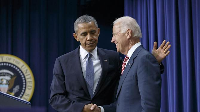 President Barack Obama embraces Vice President Joe Biden, right, before signing the Workforce Innovation and Opportunity Act, bipartisan job-training legislation which aims to help job seekers gain valuable employment skills, at the Eisenhower Executive Office Building in the White House complex in Washington, Tuesday, July 22, 2014. (AP Photo/J. Scott Applewhite)