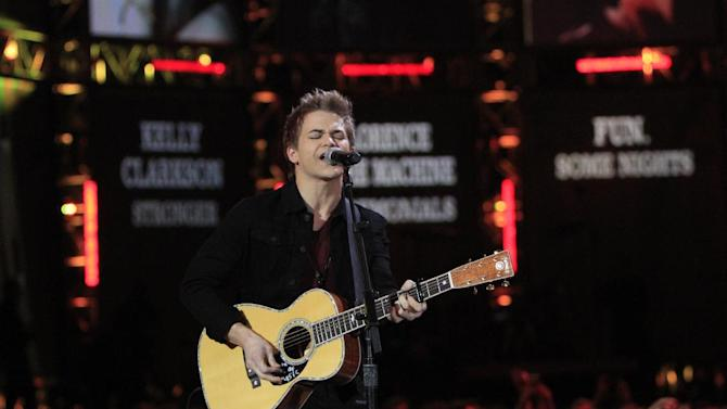 FILE - In this Dec. 5, 2012 file photo, Hunter Hayes performs at the Grammy Nominations Concert Live! at Bridgestone Arena, in Nashville, Tenn. Hayes is a nominee with six nominations at the upcoming 48th annual Academy of Country Music Awards. The show will broadcast live on CBS from the MGM Grand Garden Arena in Las Vegas on Sunday, April, 8, 2013. (Photo by Wade Payne/Invision/AP, File)