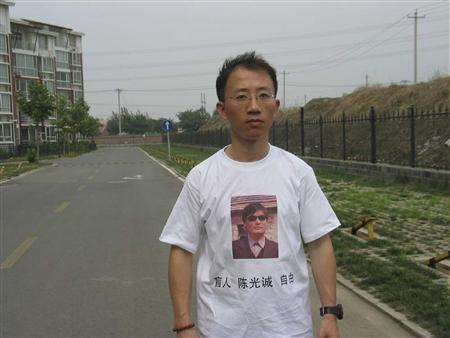 Undated file handout shows Chinese dissident, Hu Jia, wearing a shirt in support of blind Chinese lawyer Chen Guangcheng
