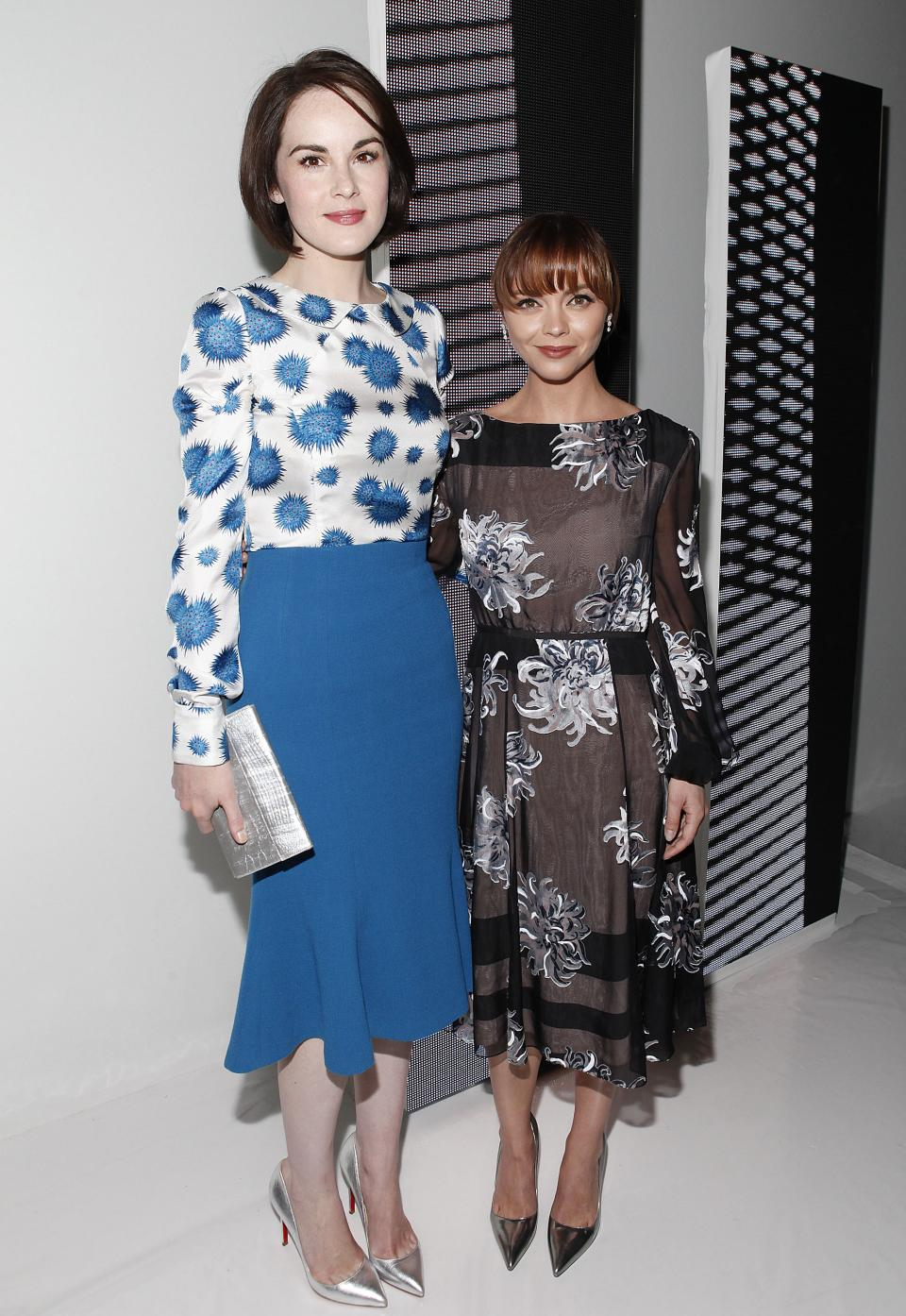 Michelle Dockery, left, and Christina Ricci attend the Carolina Herrera Spring 2014 collection on Monday, Sept. 9, 2013, during Mercedes-Benz Fashion Week in New York. (Photo by Amy Sussman/Invision/AP)