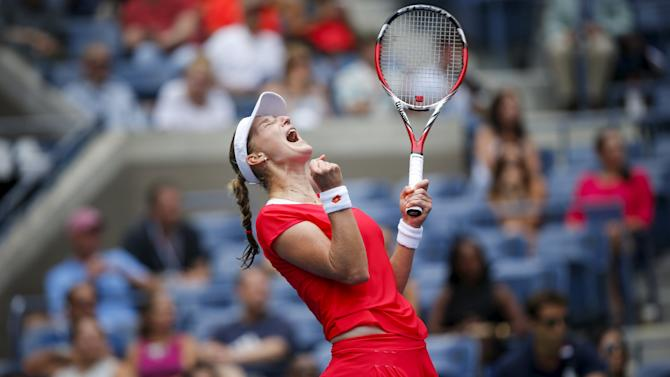Makarova of Russia celebrates after defeating Elina Svitolina of Ukraine during their match at the U.S. Open Championships tennis tournament in New York
