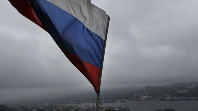 A Russian flag flies above the port in the eastern Russian city of Vladivostok Wednesday, Sept. 5, 2012. Once a mysterious closed city during Soviet times, Vladivostok is ready to strut in the world spotlight as host of the Asia-Pacific Economic Cooperation summit. Russia has splashed $20 billion preparing for the summit in Vladivostok, its largest but long-neglected Pacific port, as part of a grand plan to become a bigger player on Asian markets. (AP Photo/Vincent Yu)