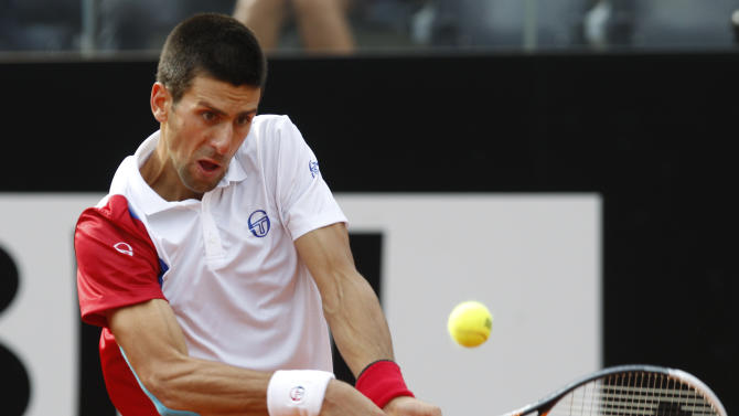 Serbia's Novak Djokovic returns the ball to France's Jo-Wilfried Tsonga during their quarter final match at the Italian Open tennis tournament, in Rome, Friday, May 18, 2012. Djokovic won 7-5, 6-1. (AP Photo/Andrew Medichini)