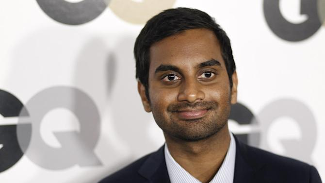 "FILE - In this Nov. 17, 20111 file photo, Aziz Ansari arrives at the 16th annual GQ ""Men of the Year"" party in Los Angeles. Penguin Press said Thursday, Aug. 22, 2013, it's acquired the actor-comedian's first book. (AP Photo/Matt Sayles, File)"