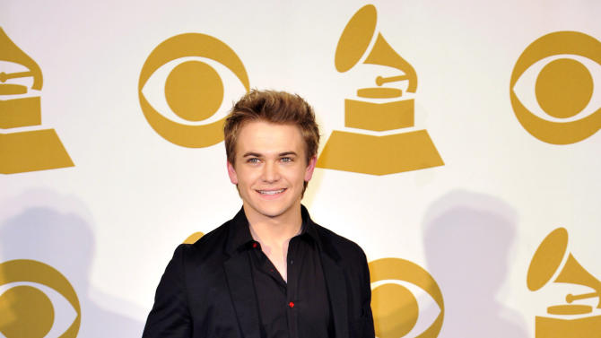 FILE - In this Dec. 5, 2012 file photo, Hunter Hayes poses for a photo backstage at the Grammy Nominations Concert Live! at Bridgestone Arena, in Nashville, Tenn. Hayes is a nominee with six nominations at the upcoming 48th annual Academy of Country Music Awards. The show will broadcast live on CBS from the MGM Grand Garden Arena in Las Vegas on Sunday, April, 8, 2013.(Photo by Donn Jones/Invision/AP, File)