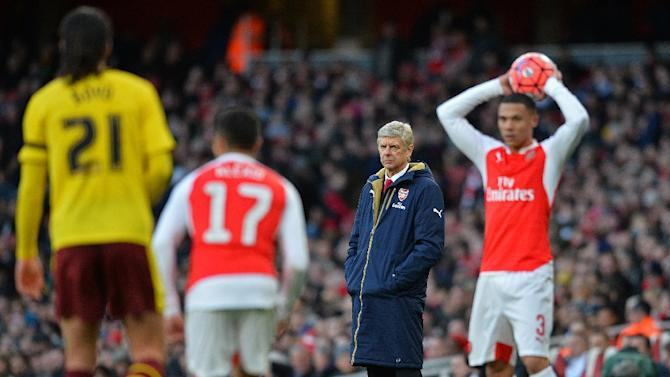 Arsene Wenger watches as Kieran Gibbs take a throw-in during an FA Cup match against Burnley at the Emirates Stadium on January 30, 2016
