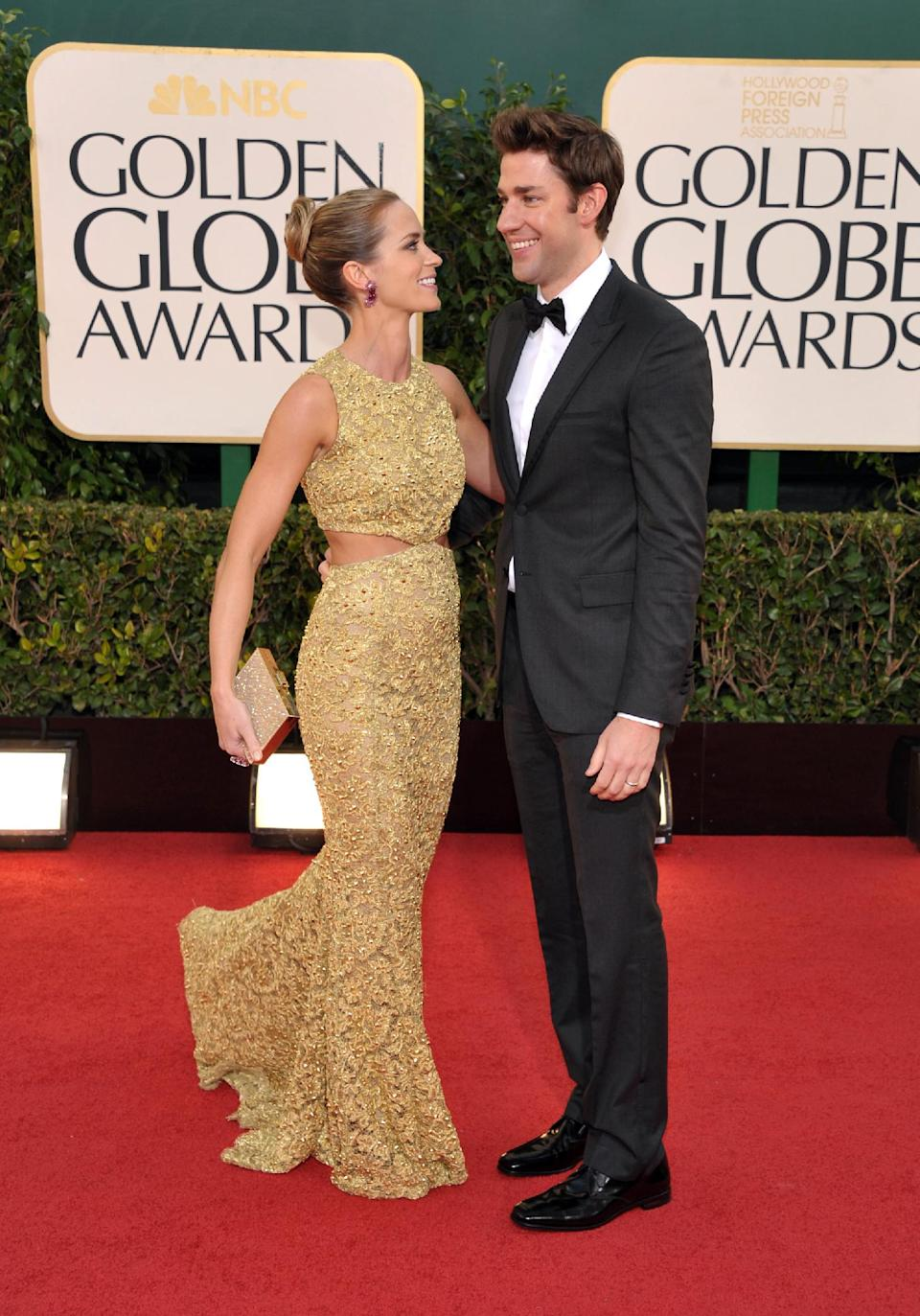 Actress Emily Blunt, left, and actor John Krasinski arrive at the 70th Annual Golden Globe Awards at the Beverly Hilton Hotel on Sunday Jan. 13, 2013, in Beverly Hills, Calif. (Photo by John Shearer/Invision/AP)