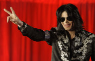 FILE - In a March 5, 2009 file photo US singer Michael Jackson announces that he is set to play ten live concerts at the London O2 Arena in July, which he announced at a press conference at the London O2 Arena. A trial scheduled to begin Tuesday, Sept. 6, 2012 will determine how much a businessman working with Katherine Jackson will have to pay her sons estate for infringing some of its copyrights. (AP Photo/Joel Ryan, File)