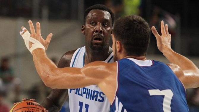 Philippines' Andray Blatche (left) vies for the ball with France's Joffrey Lauvergne during the friendly basketball match between France and Philippines in Antibes, southeastern France on August 15, 2014