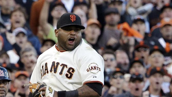 San Francisco Giants' Pablo Sandoval reacts after thinking he picked off St. Louis Cardinals' Yadier Molina at third during the second inning of Game 7 of baseball's National League championship series Monday, Oct. 22, 2012, in San Francisco. Molina was called safe. (AP Photo/David J. Phillip)