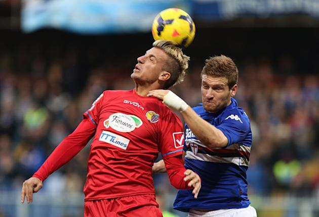 Catania forward Gaston Maximiliano Maxi Lopez, left, heads the ball past Sampdoria defender Shkodran Mustafi, during a Serie A soccer match between Sampdoria and Catania, in Genoa, Italy, Sunday, Dec.