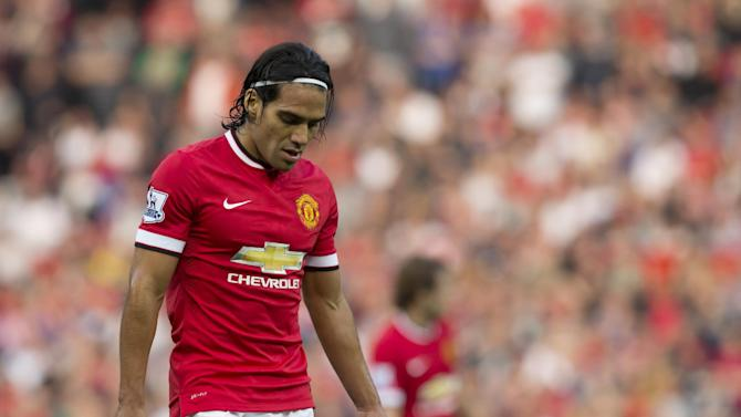 FILE - In this Sept. 14, 2014 file photo, Manchester United's Radamel Falcao Garcia walks on the field during his team's English Premier League soccer match at Old Trafford Stadium in Manchester, England. (AP Photo/Jon Super, File)