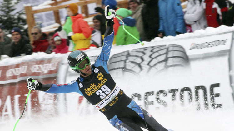 Steven Nyman, of the United States, celebrates after winning an alpine ski, men's World Cup downhill, in Val Gardena, Italy, Saturday, Dec. 15, 2012. (AP Photo/Alessandro Trovati)