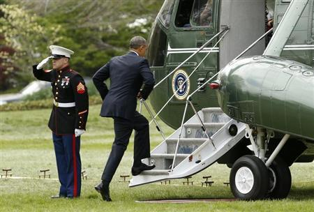 U.S. President Obama boards Marine One as he departs the White House in Washington for a week-long trip to Asia,