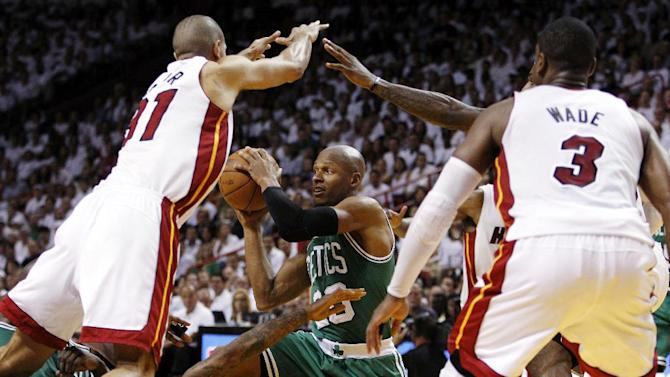 File - In this June 5, 2012, file photo, Boston Celtics' Ray Allen (20) looks to pass the ball as Miami Heat's Shane Battier (31) and Dwyane Wade (3) defend during the second half of Game 5 in their NBA basketball Eastern Conference Finals playoff series in Miami. Allen told the Heat on Friday night, July 6, 2012, that he has decided to leave the Celtics and join up with the reigning NBA champions. (AP Photo/Lynne Sladky, File)