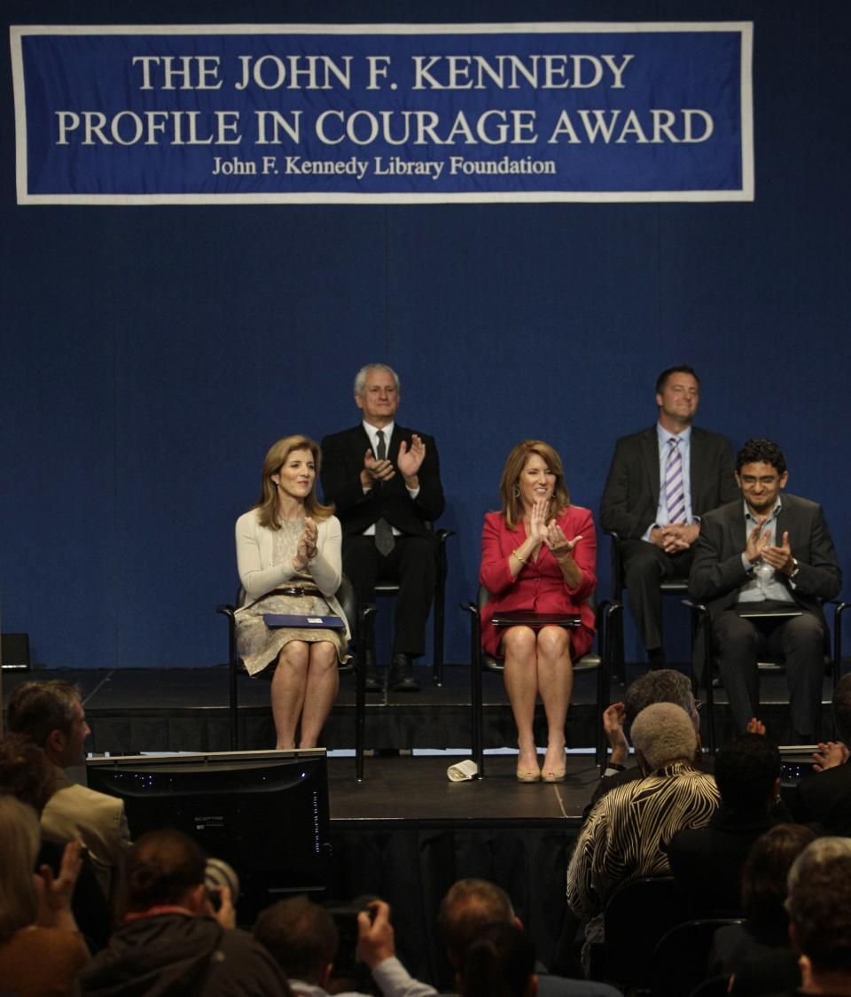 Caroline Kennedy, left, applauds recipients of the John F. Kennedy Profiles in Courage Award, Elizabeth Redfenbaugh, center and Egyptian Wael Ghonim, right, at the JFK Library & Museum in Boston, Monday morning, May 23, 2011. (AP Photo/Stephan Savoia)