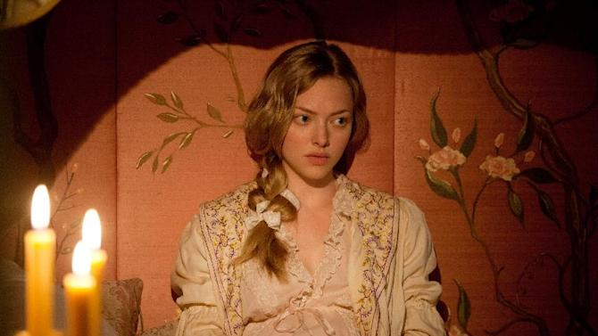 """This film image released by Universal Pictures shows Amanda Seyfried as Cosette in a scene from """"Les Miserables."""" (AP Photo/Universal Pictures, Laurie Sparham)"""