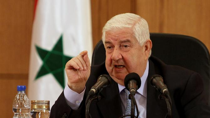 """Syrian Foreign Minister Walid al-Moallem speaks during a press conference in Damascus, Syria on Tuesday, August 27, 2013. Syria's foreign minister said Tuesday his country would defend itself using """"all means available"""" in case of a U.S. strike, denying his government was behind an alleged chemical weapons attack near Damascus and challenging Washington to present proof backing up its accusations.(AP Photo)"""