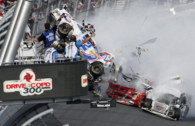 Kyle Larson's car (32) gets airborne during a multi-car wreck on the final lap of the NASCAR Nationwide Series auto race Saturday, Feb. 23, 2013, at Daytona International Speedway in Daytona Beach, Fl