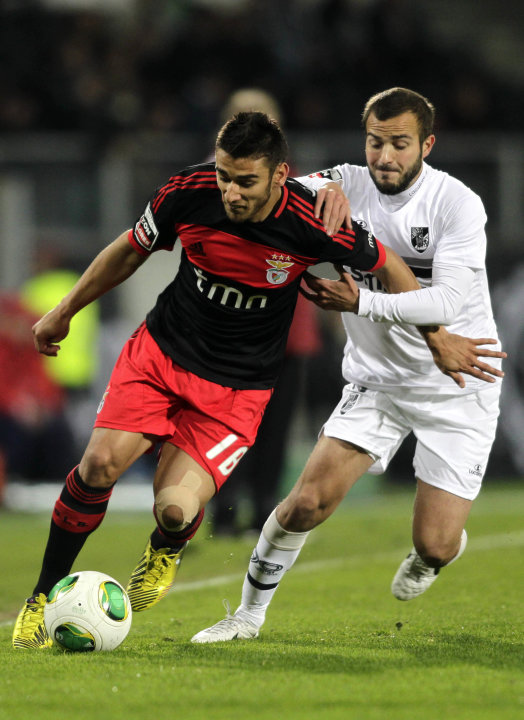 Guimaraes' Andre Bras batles for the ball with Benfica's Salvio during their Portuguese Premier League soccer match in Guimaraes