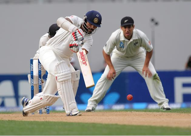 India's Shikar Dhawan bats against New Zealand on the third day of the first cricket test at Eden Park in Auckland, New Zealand, Saturday, Feb. 8, 2014.(AP Photo/SNPA, Ross Setford) NEW ZEALAND OUT