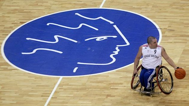 Britan's Pollock during preliminary Group A wheelchair basketball match against Italy at the Paralympic Games in Athens (Reuters)