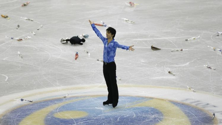 Hanyu of Japan reacts after performing during the men's short programme at the ISU Grand Prix of Figure Skating Final in Fukuoka